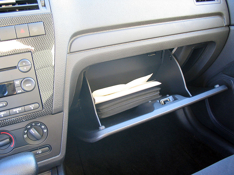 image of car owners manual in glove compartment